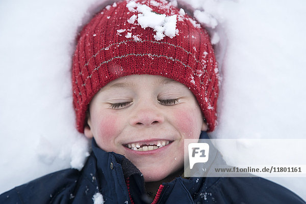Smiling boy on snow