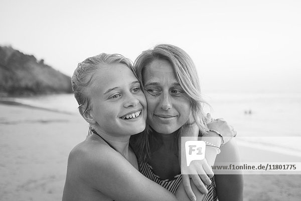 Girl with mother on beach