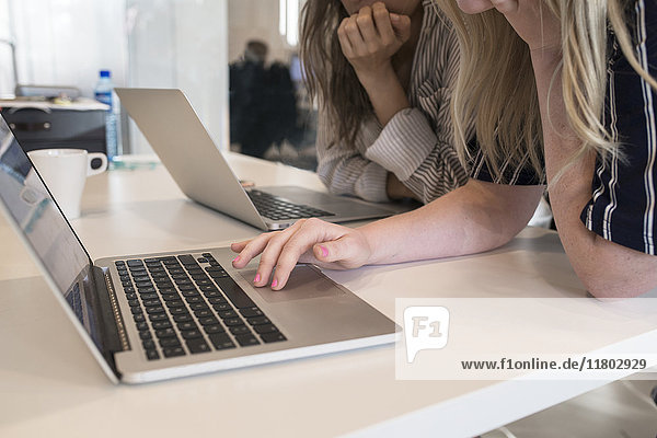 Women using laptop