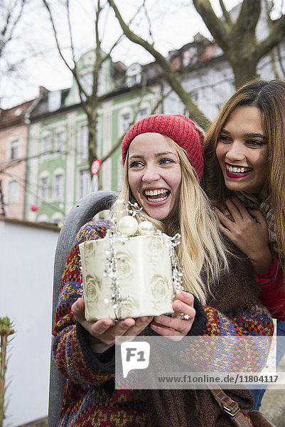 Young women holding Christmas gift