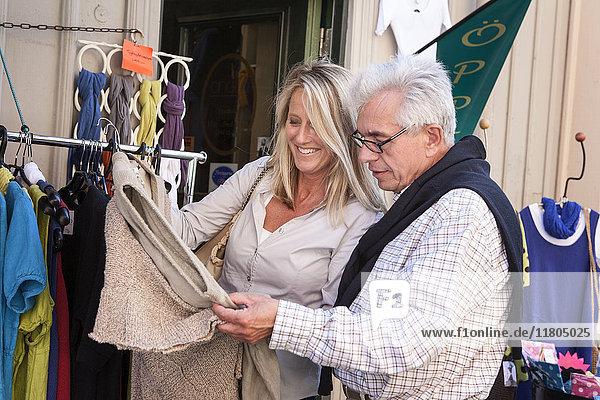 Mature couple in clothes shop