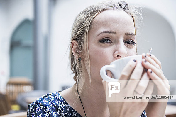 Close-up of beautiful woman drinking coffee
