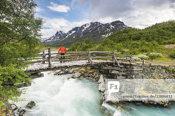 Hiker looking at waterfall