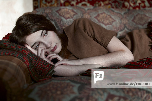 Caucasian woman laying on sofa