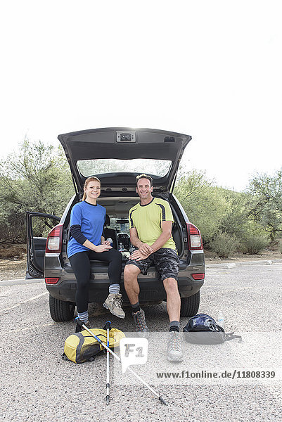 Portrait of hikers sitting in car