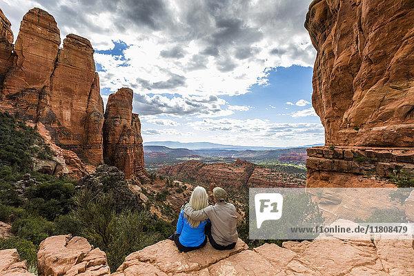 Caucasian couple admiring scenic view in desert landscape