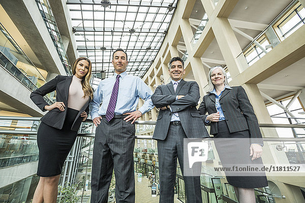 Portrait of smiling business people in lobby