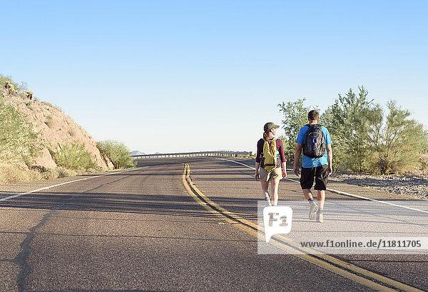 Couple hiking on winding street