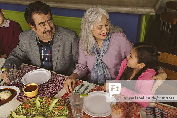 High angle view of grandparents and grandchildren in restaurant
