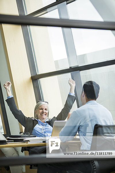 Business people celebrating in meeting