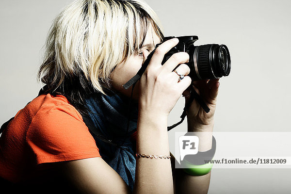 Close up of Caucasian teenage girl photographing with camera