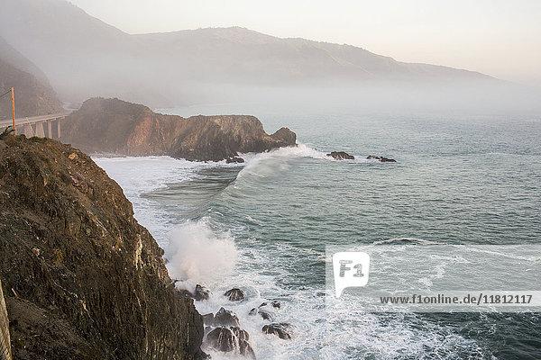 Waves splashing on rocks at cliffs