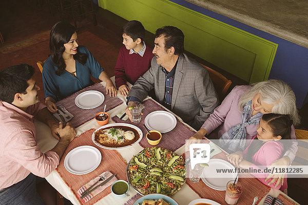 High angle view of family enjoying dinner in restaurant
