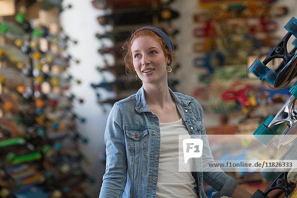 Portrait of woman in skateboard shop