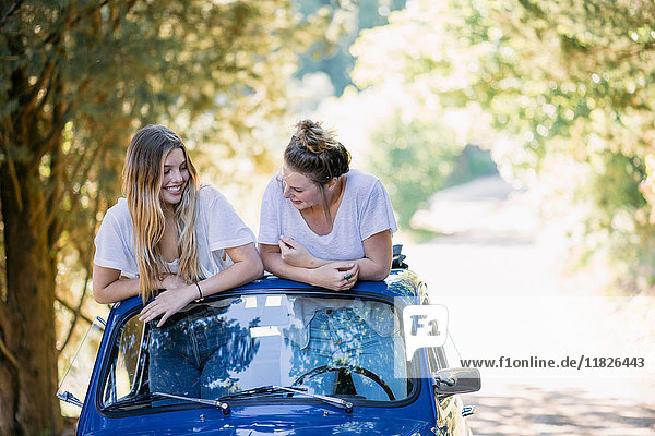 Young women in vintage convertible car  Firenze  Toscana  Italy  Europe