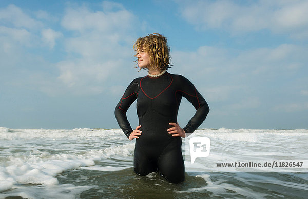 Girl standing in the North Sea wearing wetsuit