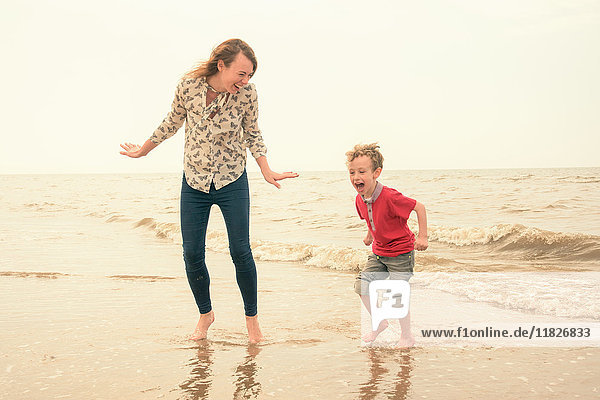 Young woman and son playing in sea