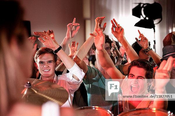 Teenage boys at rock concert