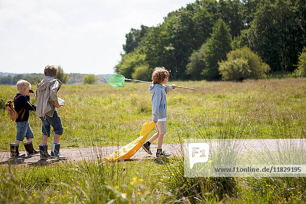 Children walking on dirt road