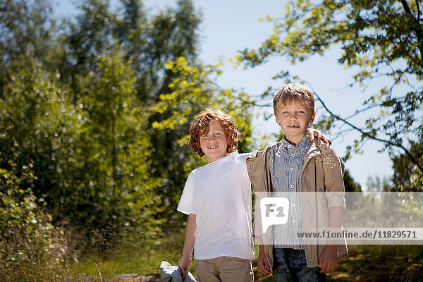 Smiling children hugging outdoors