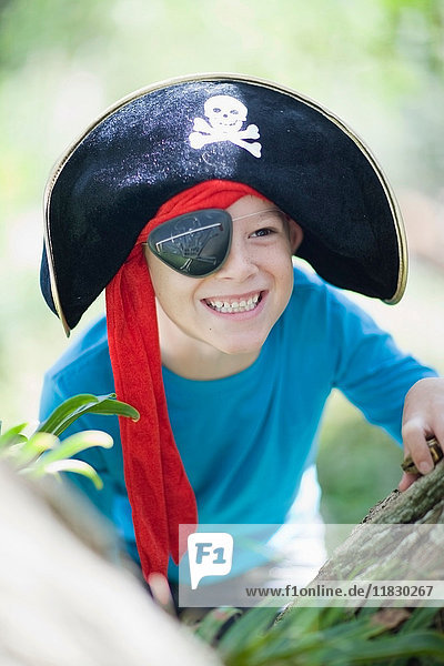 Boy playing in pirate costume