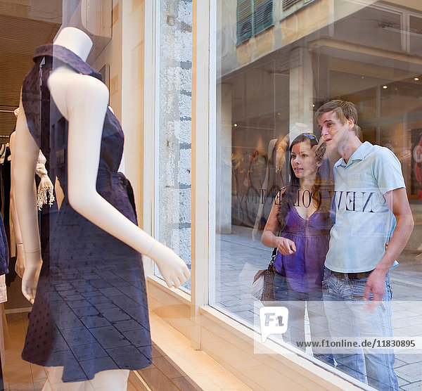 Couple window shopping together