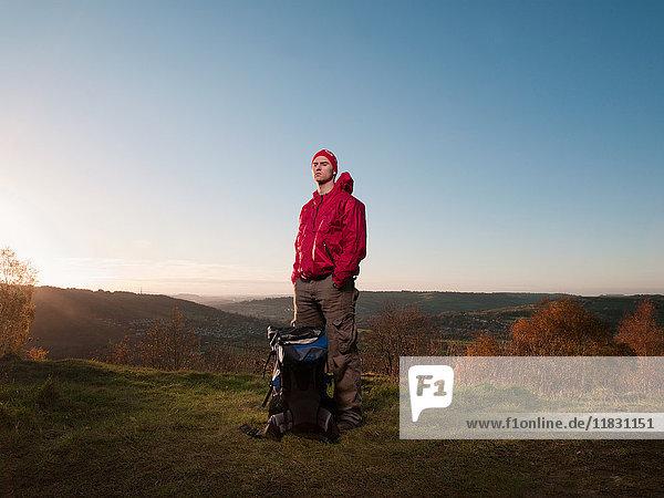 Hiker standing in rural landscape