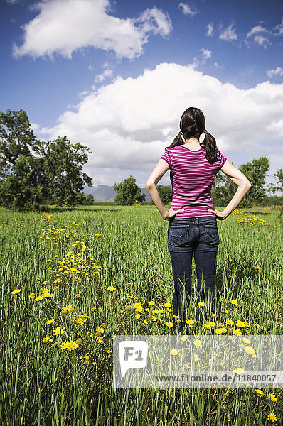 Mixed Race woman standing in field