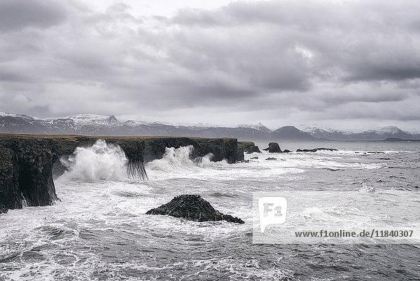 Ocean waves splashing on cliffs  Hellissandur  Snaellsnes peninsula  Iceland
