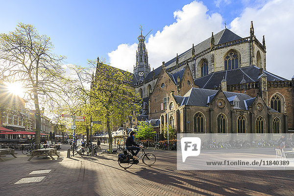Bicycles in the pedestrian square next to the ancient church Grote Kerk  Haarlem  North Holland  The Netherlands  Europe