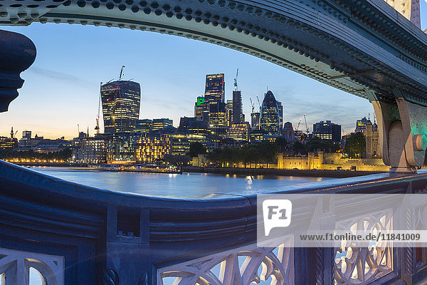 View of City of London skyline from Tower Bridge at dusk  London  England  United Kingdom  Europe
