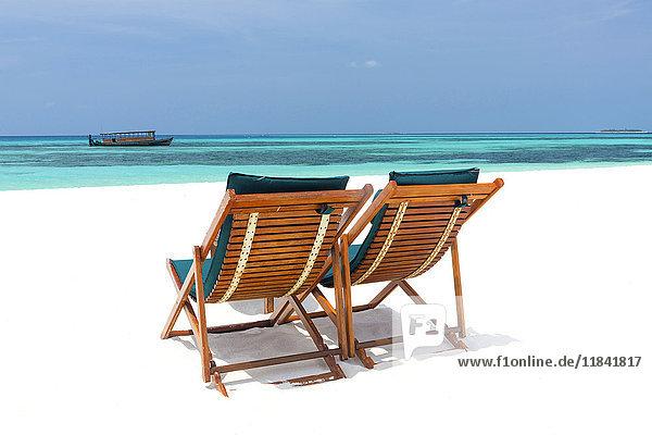 Wooden sun loungers on beach  Coco Palm  Dhuni Kolhu  Baa Atoll  Republic of Maldives  Indian Ocean  Asia