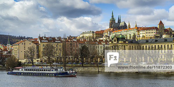 'A boat on the Vltava River with a view of the city of Prague; Prague  Czech Republic'