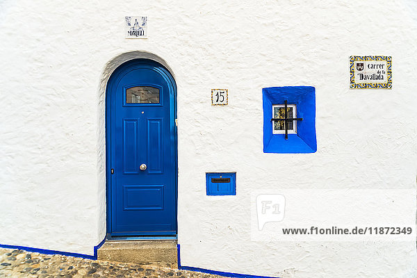 'Traditional house with the classical Mediterranean colours  white walls and blue windows and doors; Sitges  Barcelona province  Spain'