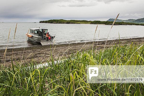 A boat lands at Kukak Bay  Katmai National Park & Preserve  Southwest Alaska  USA
