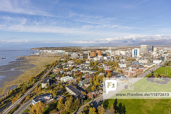 Aerial view of downtown Anchorage  Delaney Park Strip and the Cook Inlet in autumn  Southcentral Alaska  USA