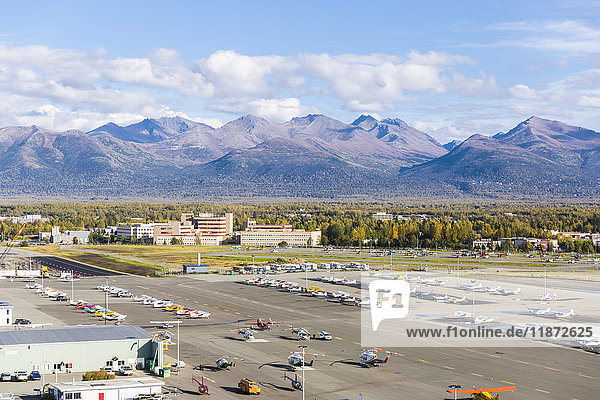 View overlooking Merrill Field municipal airport and Alaska Regional Hospital with Chugach Mountains in the background  Anchorage  Southcentral Alaska  USA
