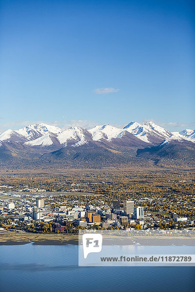 Aerial view of downtown Anchorage  Cook Inlet  and the Chugach Mountains in autumn  Southcentral Alaska  USA