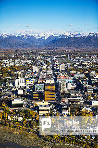 Aerial view of downtown Anchorage and Chugach Mountains during autumn  Southcentral Alaska  USA