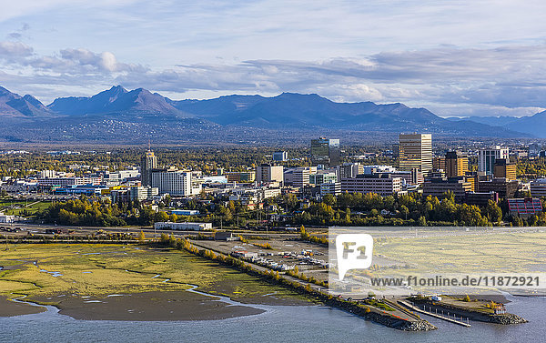 Aerial view of downtown Anchorage  mudflats of Cook Inlet  and Chugach Mountains  Southcentral Alaska  USA