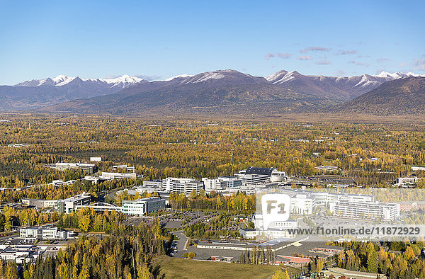 Aerial view of the University Medical District in Anchorage with Chugach Mountains in the background  Southcentral Alaska  USA