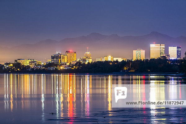 Sunset view of downtown Anchorage reflecting in Cook Inlet in autumn  Southcentral Alaska  USA