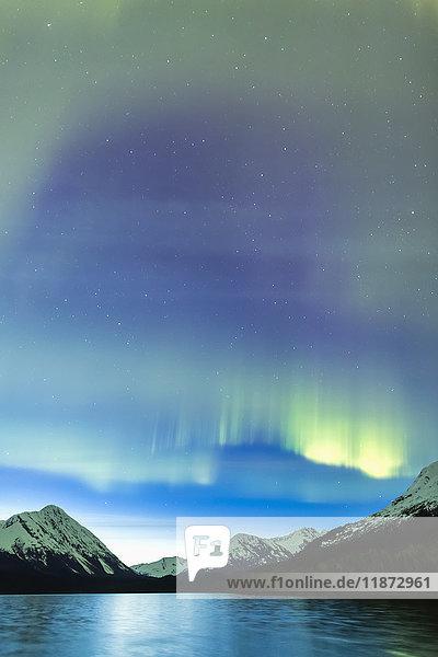 Northern lights over Kenai Mountains and Upper Trail Lake near Moose Pass  Kenai Peninsula  Southcentral Alaska  USA