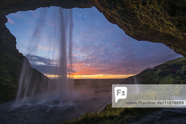 'Seljandafoss  a beautiful waterfall that you can walk behind  at sunset on the South coast of Iceland; Iceland'