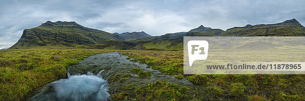 'Panoramic view of a meltwater stream coming from the mountains along the south coast of Iceland; Iceland'