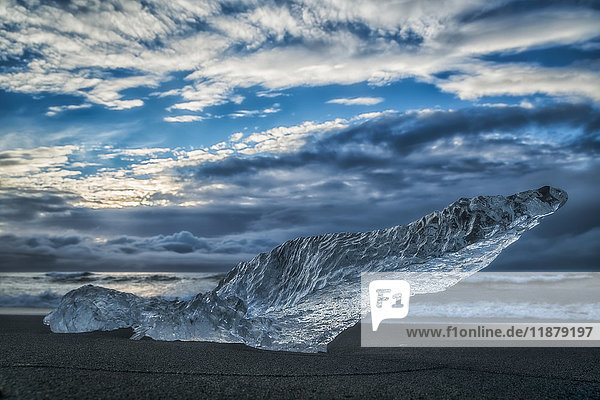 'Diamond Beach  along the South Coast of Iceland and is an area where ice chunks from Jokulsarlon are deposited on the beach after each high tide; Iceland'