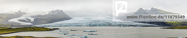 'The majestic Fjallsarlon is an iceberg lagoon at the south end of the glacier Vatnajokull. On the lagoon  you can see floating icebergs that calf from the edge of the glacier; Iceland'