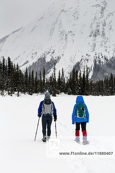 'Two women snowshoeing in the mountains  East of Field; British Columbia  Canada '