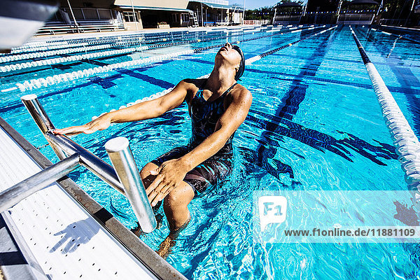 Swimmer in water at end of pool
