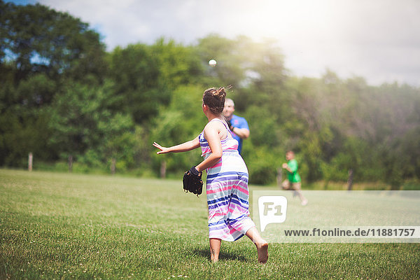 Girl playing baseball on field